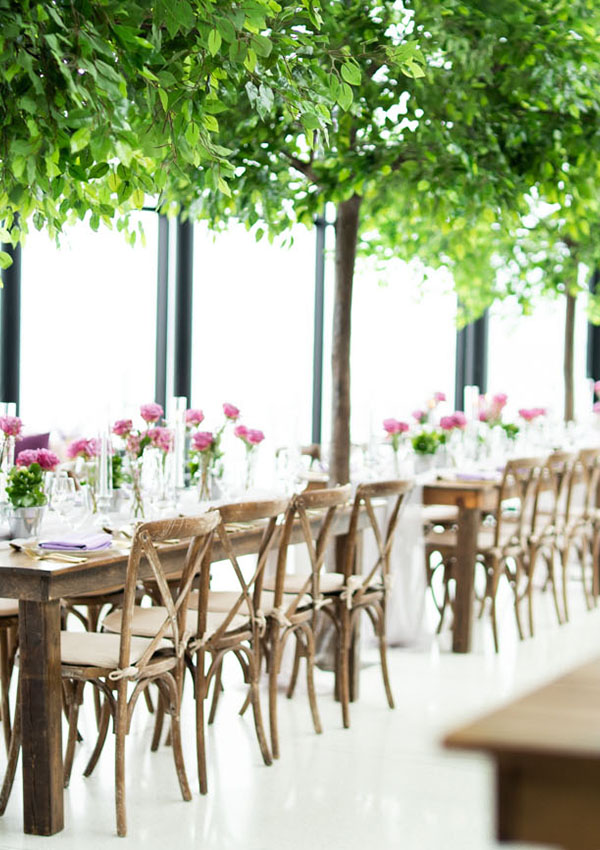 Isles of harvest tables and cross back wooden chairs