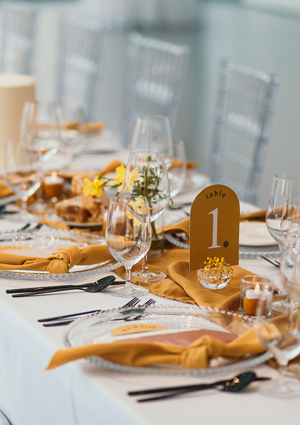 White table linen with honey coloured accents
