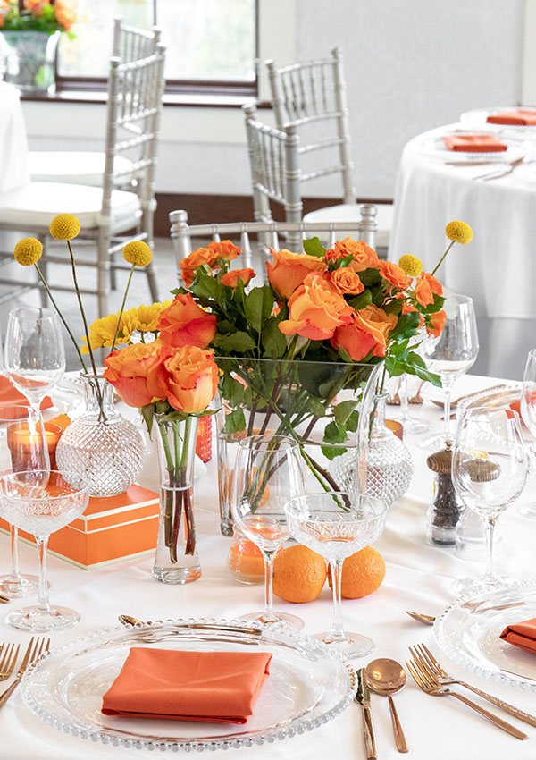 White table linens with orange accents